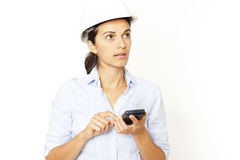 Female architect calculating looking to a side. Female architect calculating on white background and looking to side Royalty Free Stock Photography