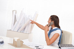 Female architect calling with phone at the office Royalty Free Stock Images