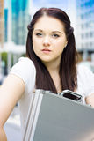 Female Architect Carrying Plans In Briefcase Stock Photo