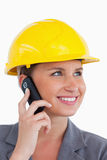 Female architect with cellphone and helmet on Stock Photos