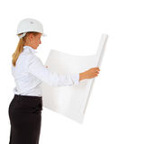 Female architect checking blueprint Stock Photography