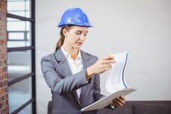 Female architect checking documents Royalty Free Stock Photos