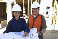 Female Architect And Co-Worker At Site Stock Image