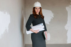 Female architect at the construction site with drawings and note Royalty Free Stock Photos