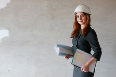 Female architect at the construction site with drawings and note Stock Images