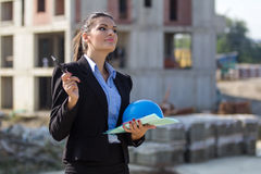 Female architect at a construction site Stock Photo