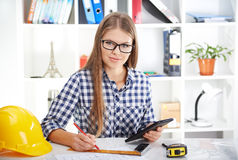 Female architect with digital tablet Stock Image
