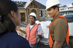Female Architect In Discussion With Co-Workers royalty free stock image