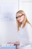 Female Architect With Documents At Desk Stock Images