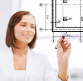 Female architect drawing blueprint Royalty Free Stock Images