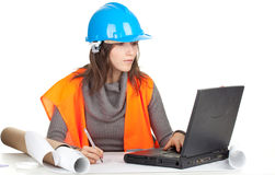 Female architect or engineer, laptop and blueprint Stock Photo
