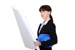 Female architect examining plans Stock Photography