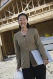 Female Architect With Hardhat And Laptop Stock Photo