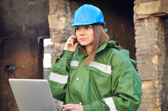 Female architect with helmet Royalty Free Stock Photos