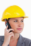 Female architect on her cellphone with helmet on Stock Image