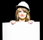 Female architect holding blank blueprint design Royalty Free Stock Image