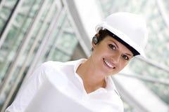 Female architect holding blueprints Stock Images