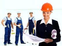 Female architect holding blueprints Royalty Free Stock Image