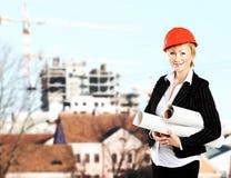Female architect holding blueprintson Royalty Free Stock Photos
