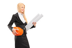 Female architect holding a helmet and a blueprint. Isolated against white background Royalty Free Stock Images
