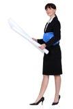 Female architect holding plans Royalty Free Stock Photo