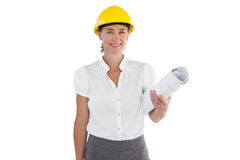 Female architect holding plans and hard hat Royalty Free Stock Photography