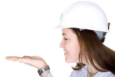 Female architect holding something on her hand Stock Photos