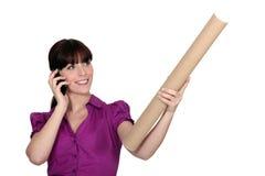 Female architect holding tube Royalty Free Stock Photography