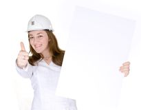 Female architect holding a white card with thumbs up Stock Photo