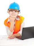 Female architect with laptop and blueprint Stock Photo