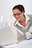 Female architect with laptop and coffee sitting Royalty Free Stock Photo