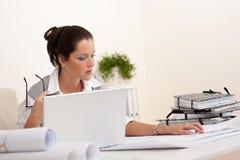Female architect with laptop sitting Stock Photo