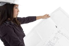 Female architect looking at blueprints Royalty Free Stock Photo