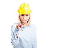 Female architect making watching you gesture Royalty Free Stock Images