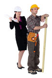 Female architect and male carpenter. Tensions between female architect and male carpenter Royalty Free Stock Image
