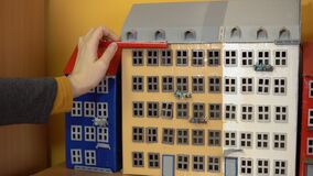 Female architect measures model house. stock footage