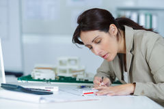 Female architect in office Royalty Free Stock Images