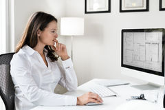 Female Architect. In Office with Computer Blue Print Stock Images