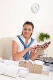 Female architect with phone at the office Royalty Free Stock Photo