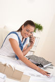 Female architect with phone sitting at office Stock Image