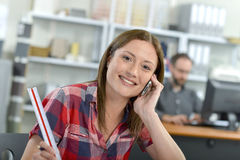Female architect on phone to client Stock Image