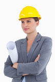 Female architect with plans and helmet on Royalty Free Stock Photography