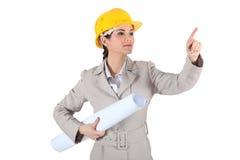 Female architect pointing Stock Photo