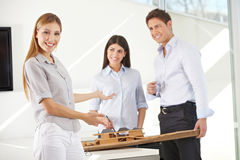 Female architect presenting house. Smiling female architect presenting 3D house draft model Stock Photos