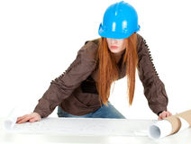 Female architect reading blueprints Stock Photo