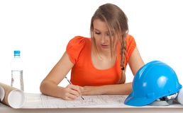 Female architect reading blueprints Royalty Free Stock Photo