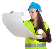 Female architect reading blueprints Stock Photography