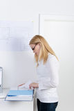 Female Architect Reading Documents At Desk Stock Photos