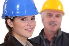 Female architect with senior builder Stock Images