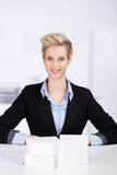 Female Architect Sitting At Desk Royalty Free Stock Photo
